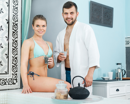 Loving couple drinking tea during wellness weekend in the spa center. Focus on both persons Standard-Bild - 123049409