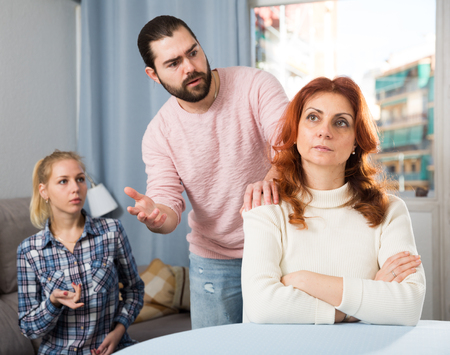 Young serious couple has a family stressful conversation at home Stock Photo