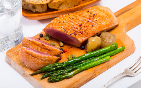 Delicious poultry dish – fried duck breast with asparagus and spices