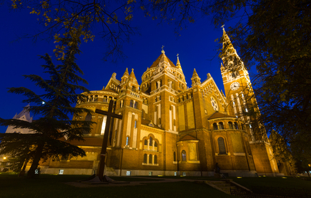 Impressive illuminated Cathedral of Our Lady on Dom square, Szeged, Hungary Фото со стока