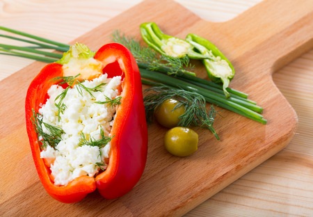 Dish of Bulgarian cuisine - bell pepper stuffed with brynza (salted sheep cheese)