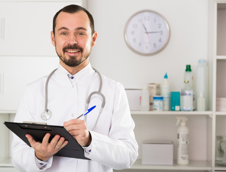 Female doctor having a productive day helping in his office
