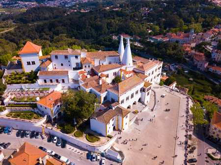 Aerial view of impressive Sintra National Palace, Portugal, EuropePicturesque landscape with Sintra National Palace at sunny spring dayView from drone of famous portuguese landmark Sintra National Palace Imagens