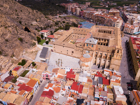 High view of Orihuela in Alicante with old University, mountains and buildings
