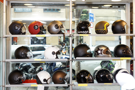 Different helmets for sale in modern shop of motorcycle riding gear