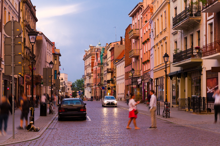 Night view of Torun streets and building illuminated at dusk, old town in Poland Stok Fotoğraf