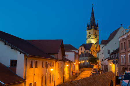 Image of streets of Sibiu with view of Cathedral in Romania. Stock Photo