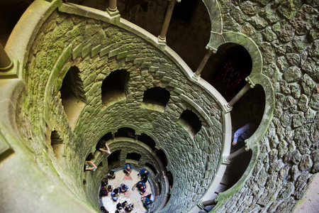 SINTRA, PORTUGAL - APRIL 21, 2019: View from top downward of spiral staircase of historical Initiation well in Quinta da Regaleira Editöryel