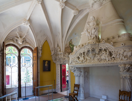 SINTRA, PORTUGAL - APRIL 21, 2019: Interior of Hunting Hall of Palace in Quinta da Regaleira with richly decorated Manueline style fireplace Editorial