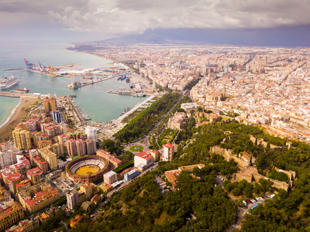 Aerial view of embankment and center of Malaga city with bullring, Spain