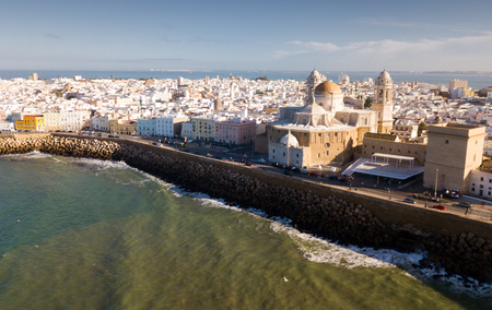 Picturesque aerial view of Spanish port city of Cadiz with medieval Cathedral in sunny spring day