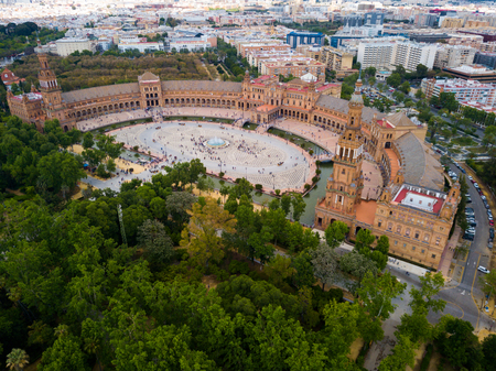 Aerial view of Plaza d'Espana with park and a bridge on ver the canal in Sevilla