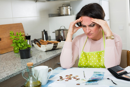 Depressed broke woman without enough money to pay bills
