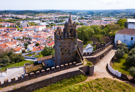 Aerial view of ruins of Montemor-o-Novo castle towering over settlement he once defended, Portugal