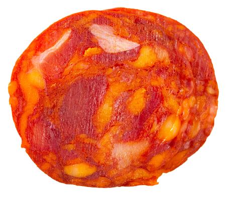 Traditional Spanish chorizo sausage slices. Isolated over white background Stock Photo