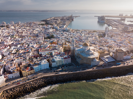 Aerial view of cityscape and harbour of Spanish city of Cadiz on peninsula in Atlantic Ocean
