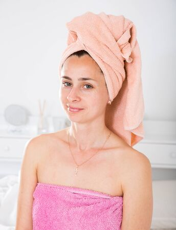 Adult woman with a towel on her head