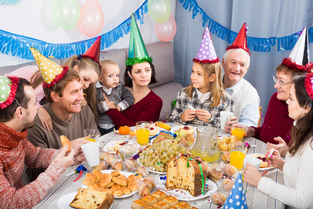 Large happy european  family celebrating children's birthday during festive dinner 免版税图像