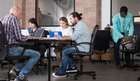 Group of multiracial people during daily work in modern co-working space Фото со стока