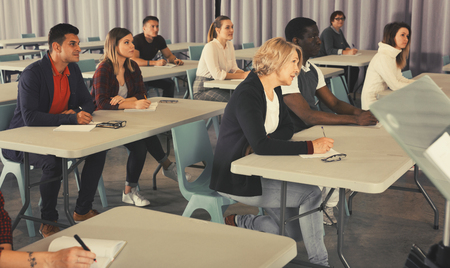 Portrait of attentive adult students on training session in auditorium Zdjęcie Seryjne