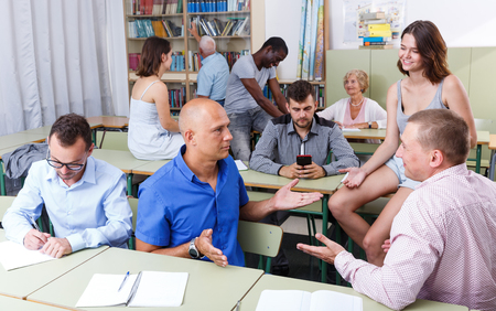 Group students different ages discussion during business course Фото со стока