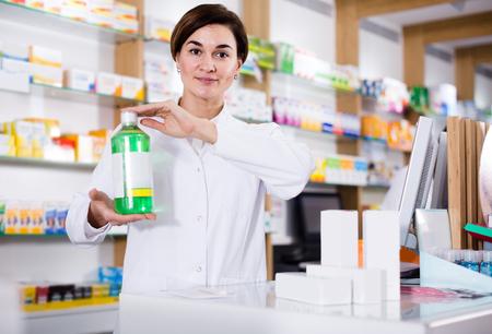 happy  pharmacist demonstrating assortment of pharmacy