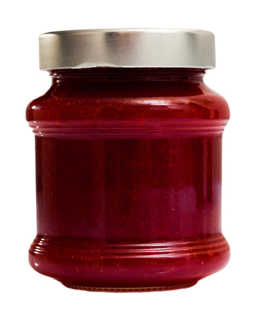 Strawberry jam in a glass jar. Isolated over white background