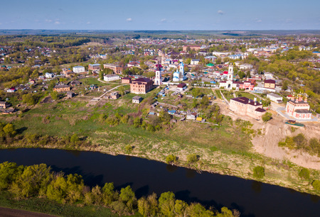 Aerial view of picturesque Belyov cityscape with Oka river overlooking domes and bell towers of several temples, Russia Stock Photo