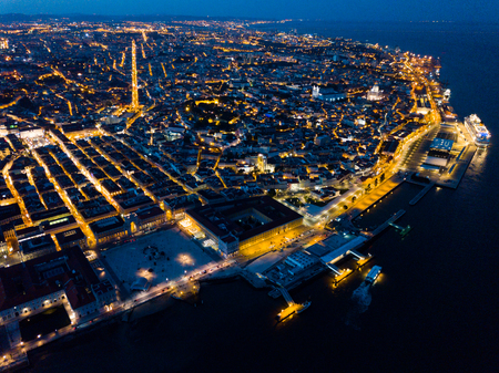Picturesque aerial view of illuminated downtown of Lisbon at night, Portugal