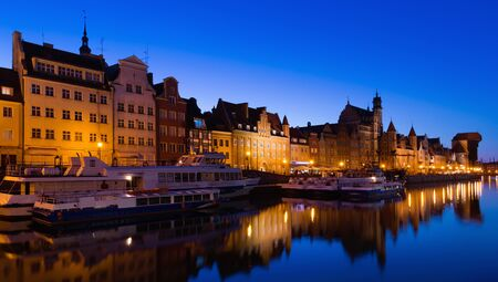 Picturesque Motlawa river embankment in old Polish town of Gdansk in twilight