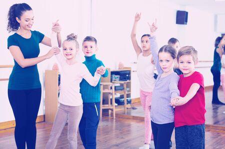 Group of positive person dancing tango in dance studio Standard-Bild