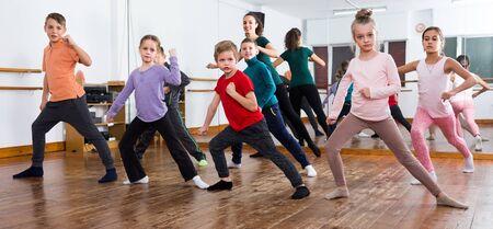 Little boys and girls dancing contemp dance in studio Фото со стока