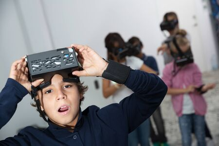 Rapturous kids are looking for way out of virtual escape room Stock fotó - 124461084
