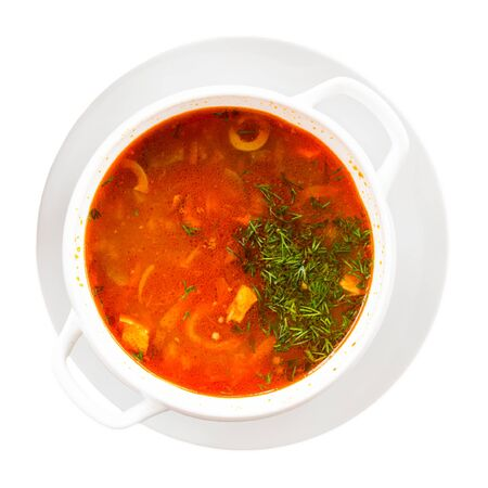 Russian cuisine - solyanka soup with various ingredients. Isolated over white background