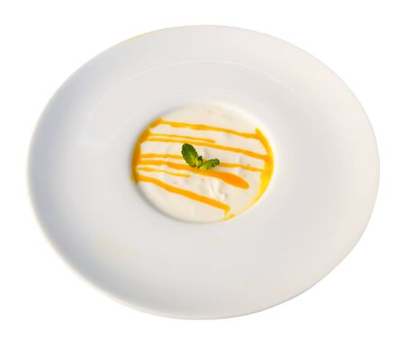 Tasty dessert – passion fruit panna cotta. Isolated over white background 写真素材