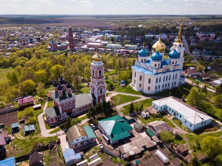 Scenic architectural ensemble of ancient Savior Transfiguration Cathedral and Trinity Church with extended bell tower on Bolkhov cityscape background, Russia Фото со стока - 124724441