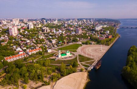 Aerial view of Admiralty square of Voronezh with Assumption Church and Ship Museum on background with modern cityscape, Russia Stock Photo
