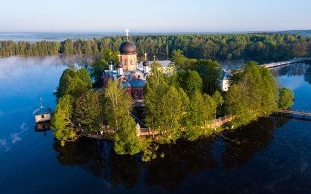 Picturesque aerial view of Pokrovsky Holy Vvedensky island hermitage - Orthodox female monastery on island on Vvedensky lake, Russia