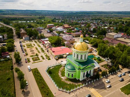 View from drone of main temple of Ozyory - Holy Trinity Cathedral on sunny spring day, Russia
