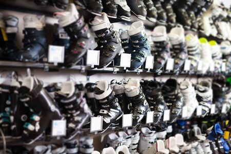 new modern ski boots for sale in modern store of sports equipment 스톡 콘텐츠