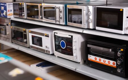 Picture of assortment of a kitchen microwave at household  appliances shop