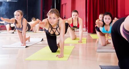 Practical yoga  for girls in a comfortable studio Stock Photo