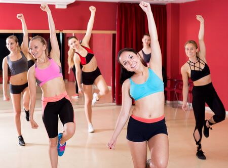 Positive girls learn the movements for a new dance in a choreographic studio