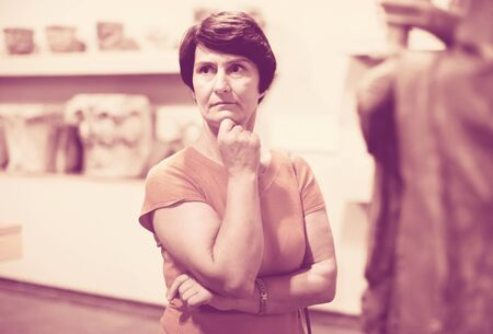 Female is looking at the exposition in historical museum
