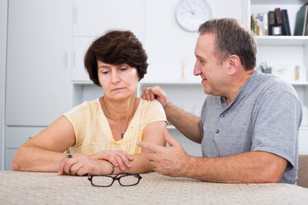 Woman experiencing family problems with partner indoors Stok Fotoğraf