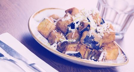Picture of plate with steamed eggplants with honey and cheese
