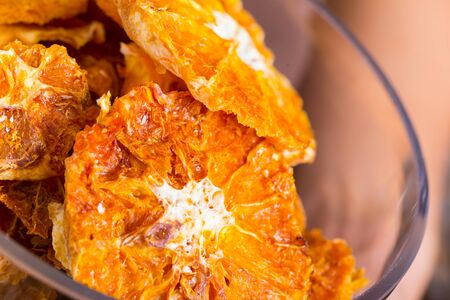 Image of dried orange in container in the store.