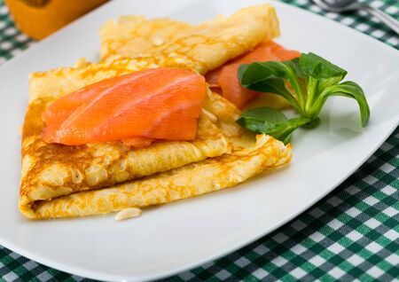 Delicious pancakes with salted salmon