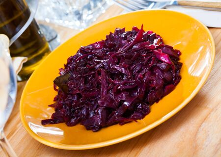 Spicy braised red cabbage as side dish or main course. Ð¡oncept of delicious healthy food