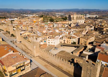 View from drone of Montblanc cityscape with battlements of fortress wall, Tarragona, Spain 写真素材